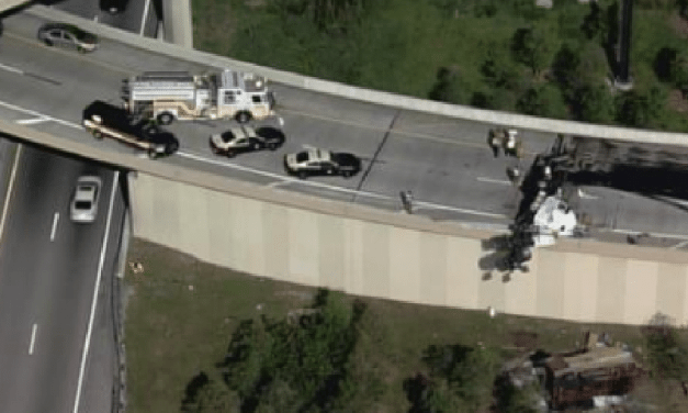 Tractor Trailer Hangs On I-95 Overpass In Florida