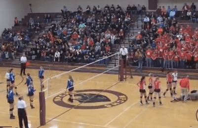 Volleyball Spike Takes Out Opponent and Fan
