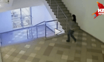 Woman Throws Herself Down The Stairs