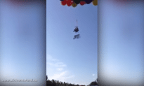 Man Lifted Into The Sky By 100 Balloons