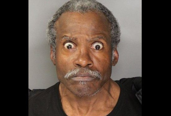 Does This Look Like The Face Of A Man Arrested For Jumping On Top Of A Police Car Wearing A Boxing Glove & Sombrero?
