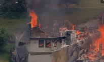 Dangling Mansion Burns to the Ground
