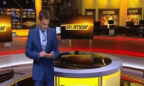 Reporter Types On Imaginary IPAD On Live Broadcast